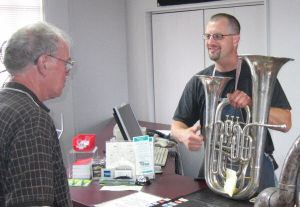 Dan ryan and Osmun Repair Tech Jim Becker examine Mr. Ryan's 1923 Conn Double Bell Euphonium